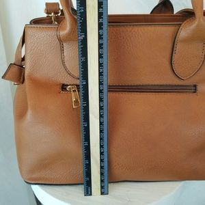 Women's designer Tan purse, leopard print lining